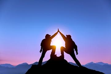 two-men-mountain-success